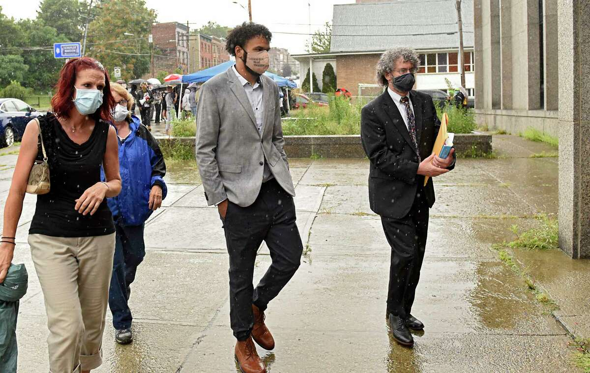 Jadyn Coutte, second from right, walks into court with his attorney Mark Mishler, right, and mother Jaime, left, as protesters in support of Justice for Jadyn are seen outside Albany City Court on Tuesday, Aug. 4, 2020 in Albany, N.Y. Jadyn appeared for his arraignment and was released on his own recognizance. Jadyn was arrested on July 10, 2020 following actions he says he took to defend his mother from aggressors. (Lori Van Buren/Times Union)