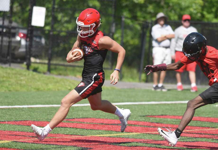 New Canaan's Drew Guida scores a touchdown during the annual Grip It and Rip It football tournament in New Canaan on Friday, July 12, 2019. Photo: Dave Stewart / Hearst Connecticut Media File Photo / Hearst Connecticut Media