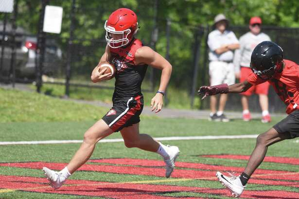 New Canaan's Drew Guida scores a touchdown during the annual Grip It and Rip It football tournament in New Canaan on Friday, July 12, 2019.