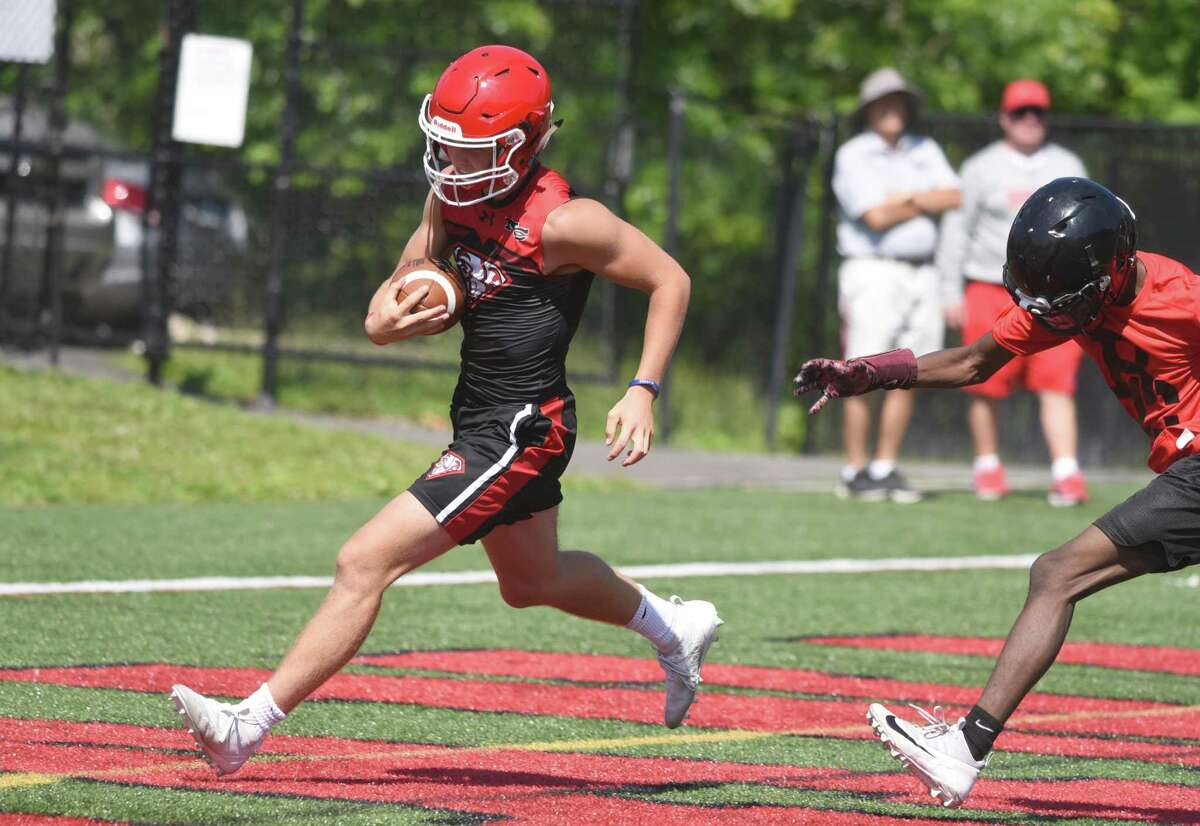 New Canaan's Drew Guida scores a touchdown during the annual Grip It and Rip It tournament in 2019.