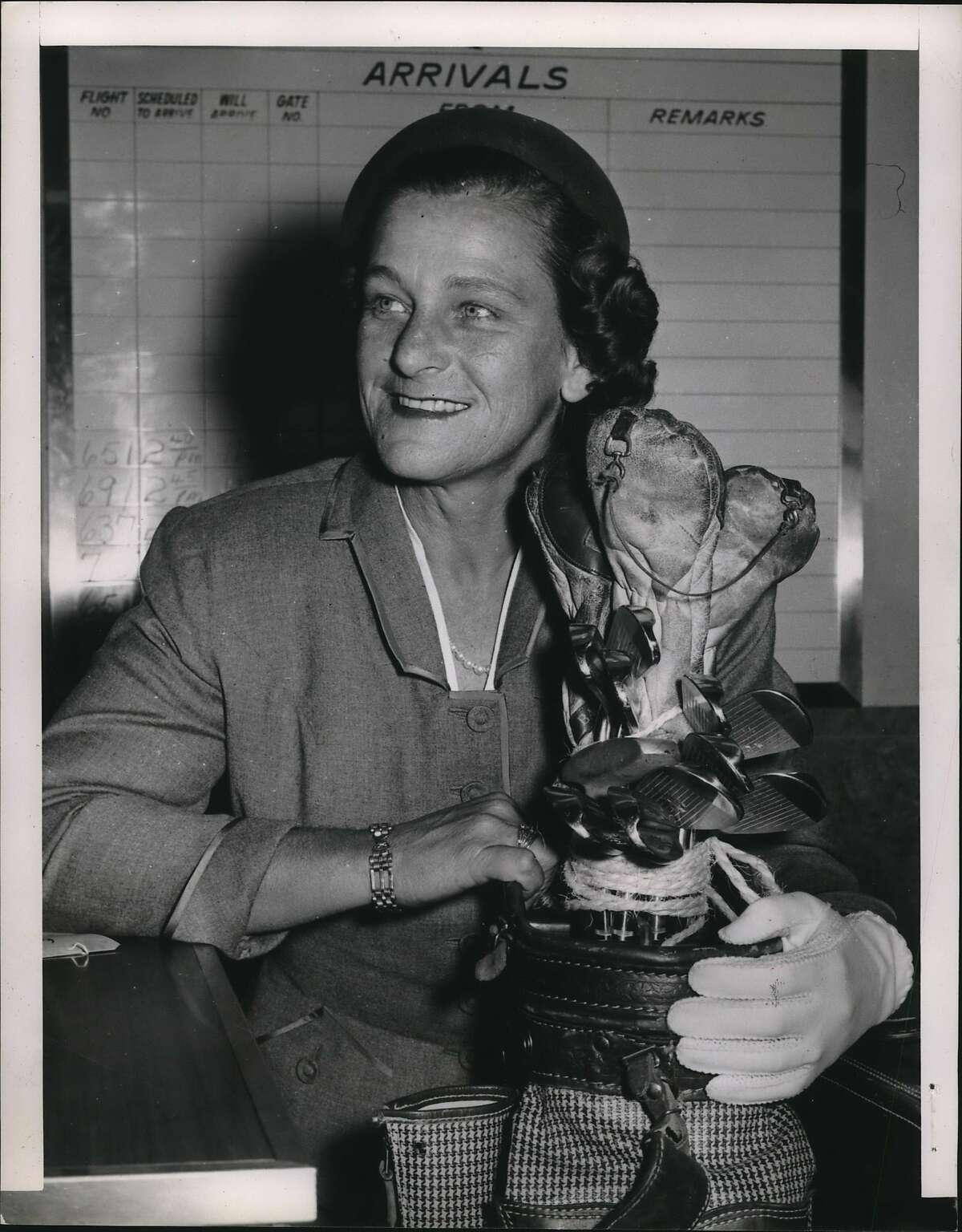 Babe Didrickson Zaharias, woman athlete. Fort Worth, Texas - Babe Didrickson Zaharias, woman athlete of the half-century, carries her golf clubs with her as she boards a plane here for Washington today. The Babe, who overcame a cancer operation to make a come-back in Tournament golf, said she had a dinner date with President and Mrs. Eisenhower at the White House tonight, but didn't know what brought on the invitation. The White House said it had no formal appointment for Mrs. Zaharias.
