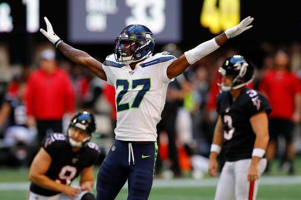 ATLANTA, GEORGIA - OCTOBER 27: Marquise Blair #27 of the Seattle Seahawks reacts after a missed field goal attempt by Matt Bryant #3 of the Atlanta Falcons in the first half at Mercedes-Benz Stadium on October 27, 2019 in Atlanta, Georgia. (Photo by Kevin C. Cox/Getty Images)