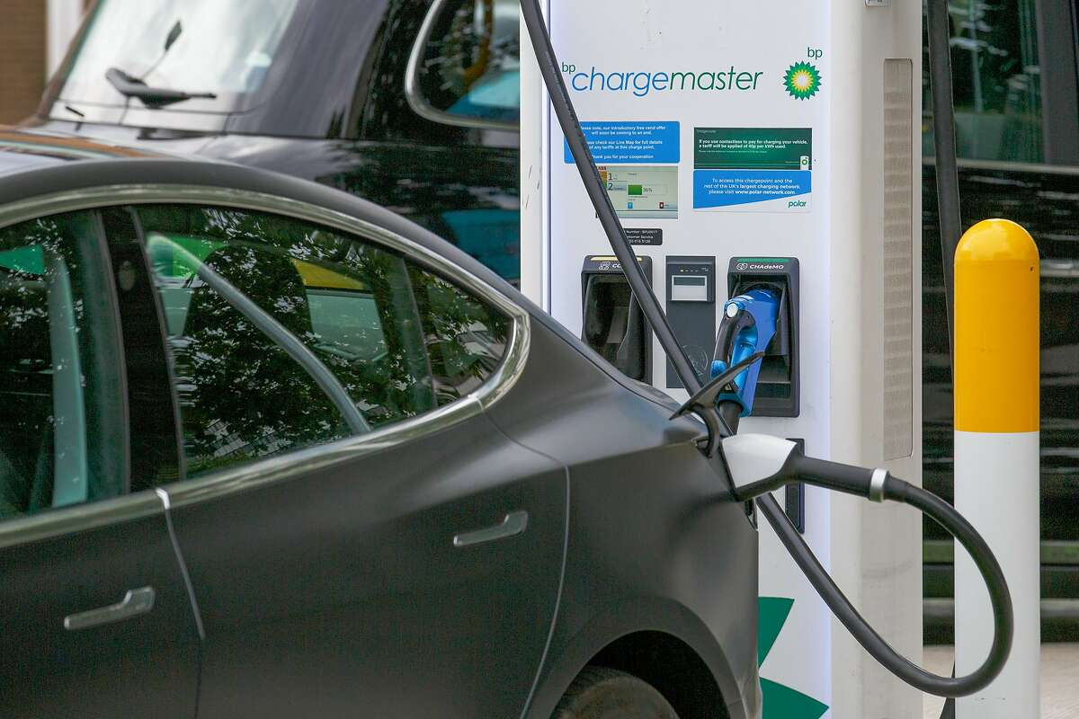 An electric car charges at a BP petrol and refueling station in London.