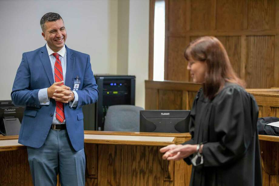 457th state District Court Interim Judge Vince Santini laughs as 284th District Court judge, Kristin Bays, shares stories about her experience with Santini in Conroe, Wednesday, August 4, 2020. Santini was appointed by Gov. Greg Abbott to fill the newly created court as an interim judge after winning the Republican nomination in a runoff. Photo: Gustavo Huerta, Houston Chronicle / Staff Photographer / Houston Chronicle © 2020