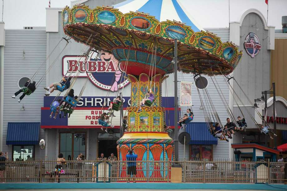 People ride the chair swing at Pleasure Pier on Sunday, March 15, 2020, in Galveston. Photo: Marie D. De Jesús, Houston Chronicle / Staff Photographer / © 2020 Houston Chronicle
