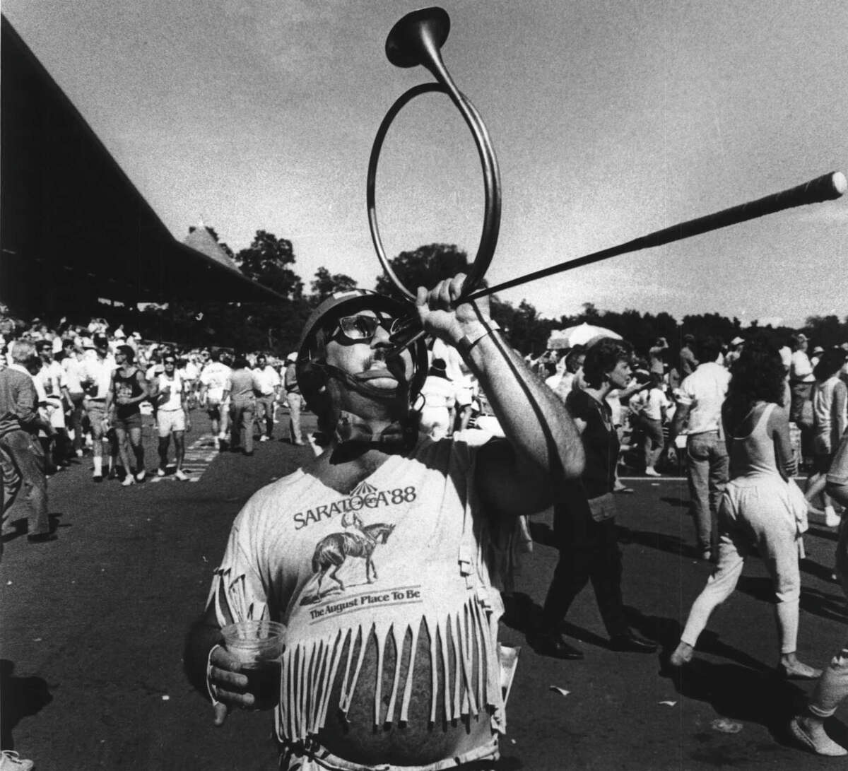 Stephen Simonelli of Everett, Massachusetts roots for 49er on Travers Day wearing a funny outfit and carrying a riding crop and hunting horn at Saratoga Race Course, New York. August 20, 1988 (John Carl D'Annibale/Times Union Archive)