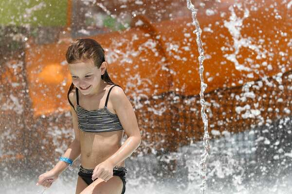 Autumn, whose declined to give her last name, enjoys the water from the children playground area of Conroe's new $5.4 million waterpark opened to the public, Wednesday, Aug. 4, 2020, in Conroe. The waterpark is opened daily from 11:00 a.m. to 6:00 p.m. features a children's pool, playground, a youth-adult pool and five water slides. Tickets are $8 per person with visitors allowed to bring coolers and food.