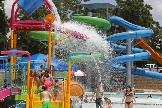 Visitors enjoy Conroe's new $5.4 million waterpark on opening day, Wednesday, Aug. 4, 2020, in Conroe. The waterpark is opened daily from 11:00 a.m. to 6:00 p.m. features a children's pool, playground, a youth-adult pool and five water slides. Tickets are $8 per person with visitors allowed to bring coolers and food.