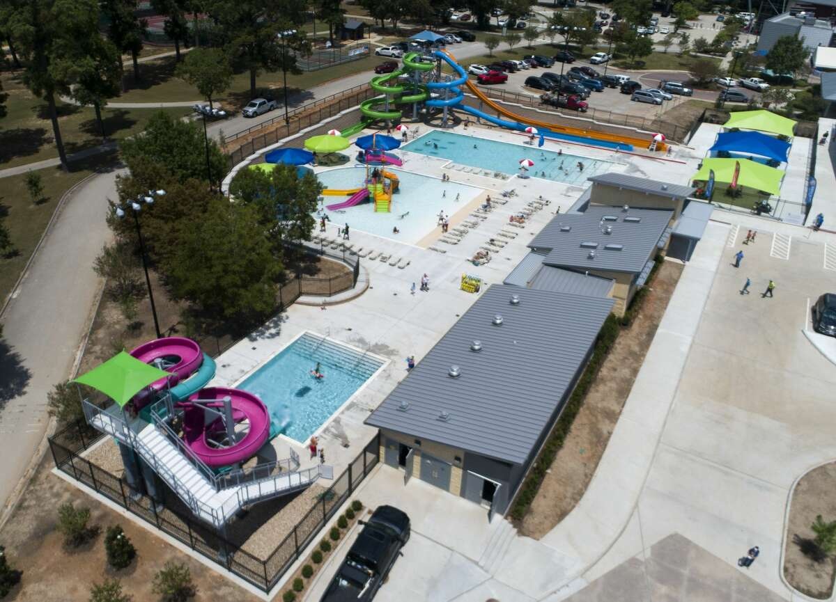 The park features a children's wading pool with a playground and an older youth-adult pool with a basketball goal and five water slides, three of which are three-story-tall tower slides.