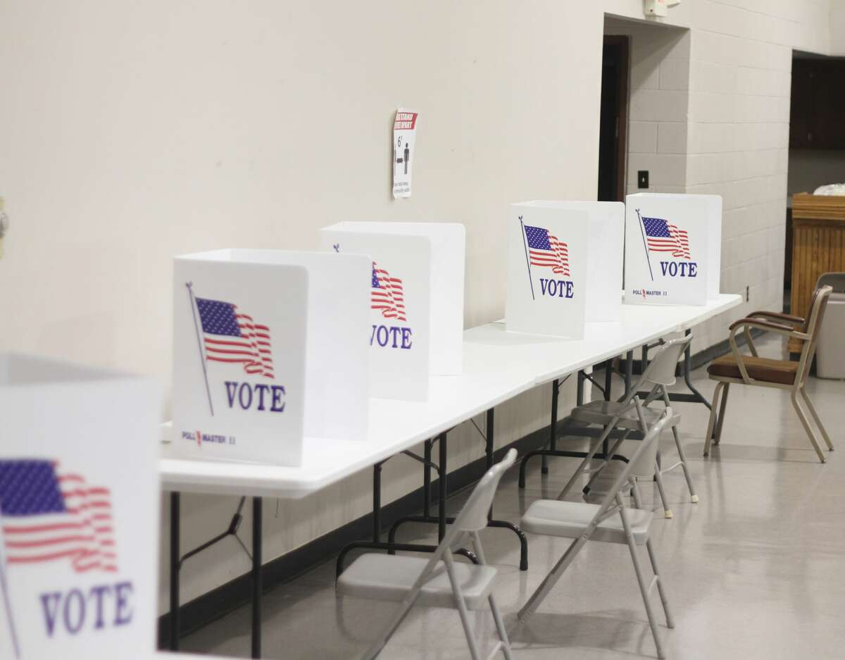 Voterscast their ballot at polling locations throughout Manistee County on Tuesday.