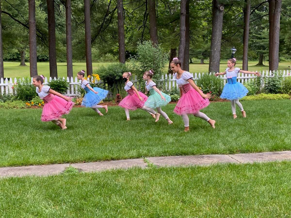 Studio D's Ballet 2b class, taught by Rebecca Darling, exits with glee, as they finish their dance to music from LaLa Land. Dancers are, from left to right, Verity Golinsky, Lydia Hyde, Ava Tong, Lila Nicholas, Caroline Gaudette and Rayne Gaudette.