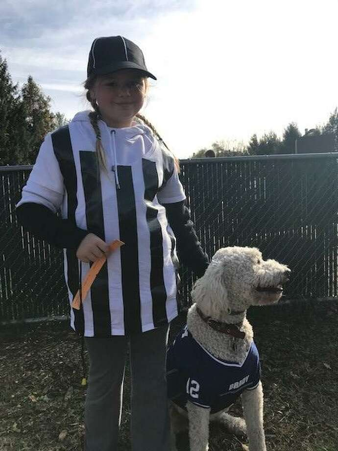 New Milford's Candlewoof dog park on Pickett District Road will hold a Halloween event Oct. 24. Above, Deborra Andersen's dog Rufus and her granddaughter, Lily Shaw, are shown at the dog park's Halloween event last year. Photo: Courtesy Of Deborra Andersen / Danbury News Times Contributed