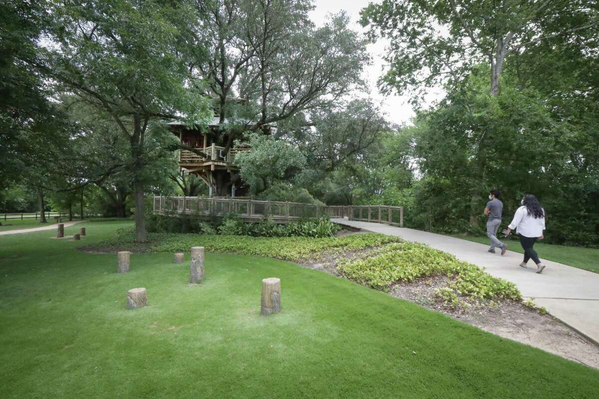 A couple make their way to the treehouse in Bridgeland's Treehouse Park Monday, July 6, 2020, in Cypress.