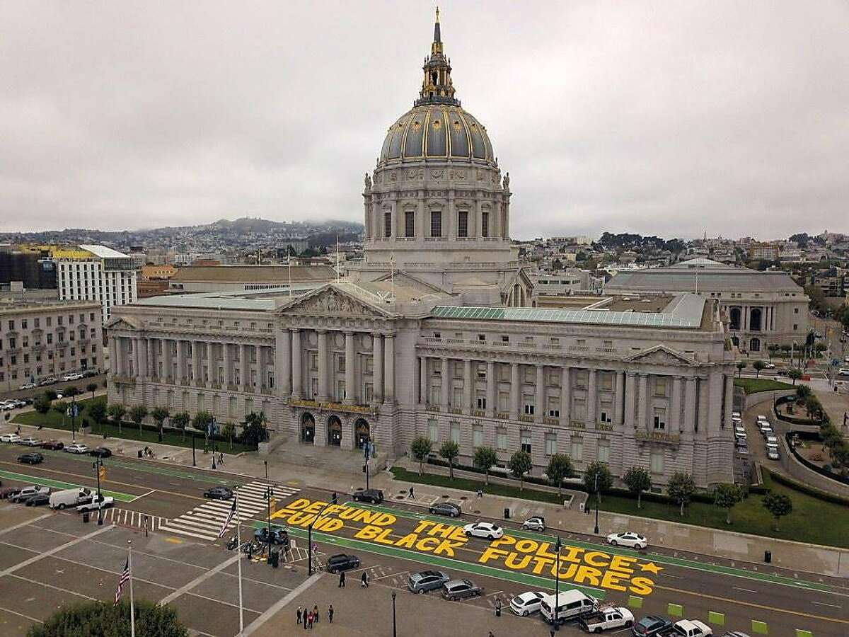 A mural reading Defund the Police Fund Black Futures is seen on Dr. Carton B, Goodlet Place next to San Francisco City Hall on Monday, July 20, 2020 in San Francisco, Calif.