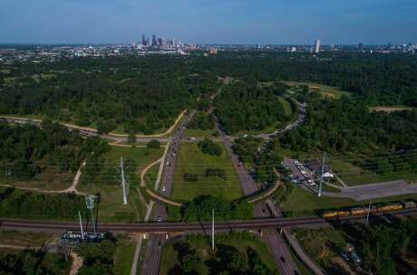 A $70 million donation by Rich and Nancy Kinder to the Memorial Park Conservancy could completely transform this portion of the park where Woodway joins Memorial Drive looking east towards downtown, photographed in 2018, by adding a new land bridge for pedestrians among other improvements. The gift to the conservancy would be the largest park donation in the city's history.