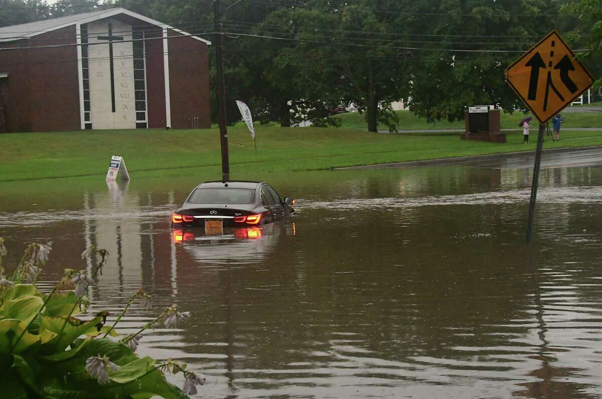 The remnants of Tropical Storm Fred are expected to hit the region on Wednesday, potentially bringing floods to parts of the Capital Region. In this photograph, acar is seen stuck stuck in water in front of Stuyvesant Plaza on Route 20which often floods with heavy rain on Tuesday, Aug. 4, 2020 in Guilderland. (Lori Van Buren/Times Union)