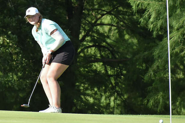 East Alton's Gracie Piar watches her putt roll to the cup for an eagle on the par 5, hole No. 11 on Tuesday at the 41st Illinois State Junior Girls Championship at Hickory Point Golf Course in Forsyth. Piar, who will be a junior at Marquette Catholic, shot 1-under par 71 to sit in a tie for fourth place halfway through the 36-hole tournament.