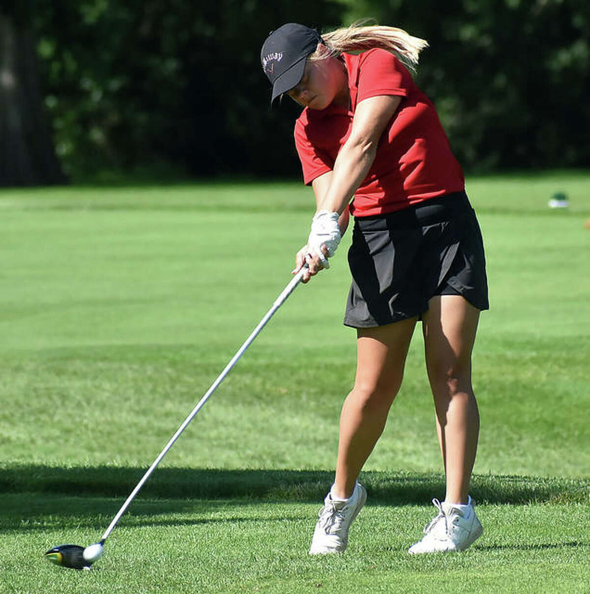 Godfrey's Audrey Cain, an incoming junior at Marquette Catholic, hits her drive at hole No. 12 Tuesday in the Illinois State Junior Girls Championship at Hickory Point Golf Course in Forsyth. Cain shot 86 and is tied for 60th place after day one of the two-day tourney.
