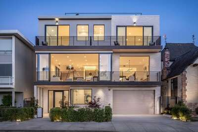 """Two large decks span the front of the home. On the main level they act as additional entertaining space, with walls of glass that push back and allow for """"endless possibilities for indoor-outdoor entertaining,"""" saidMoshayedi."""