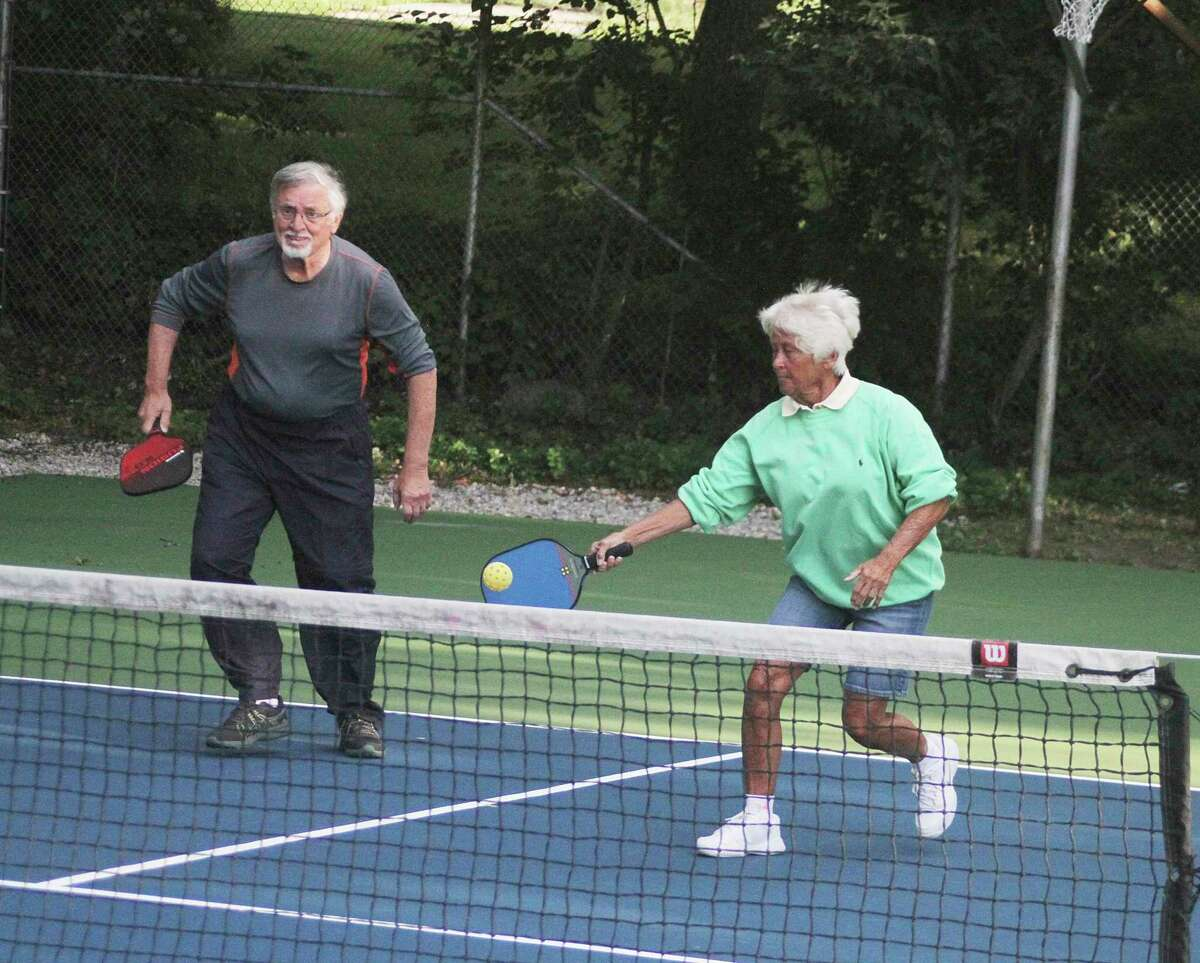 Players from theLakeside Pickleball Northwest Michigan club christen the newly resurfaced courts atCosier Park of Bear Lake on Monday. (Dylan Savela/News Advocate)