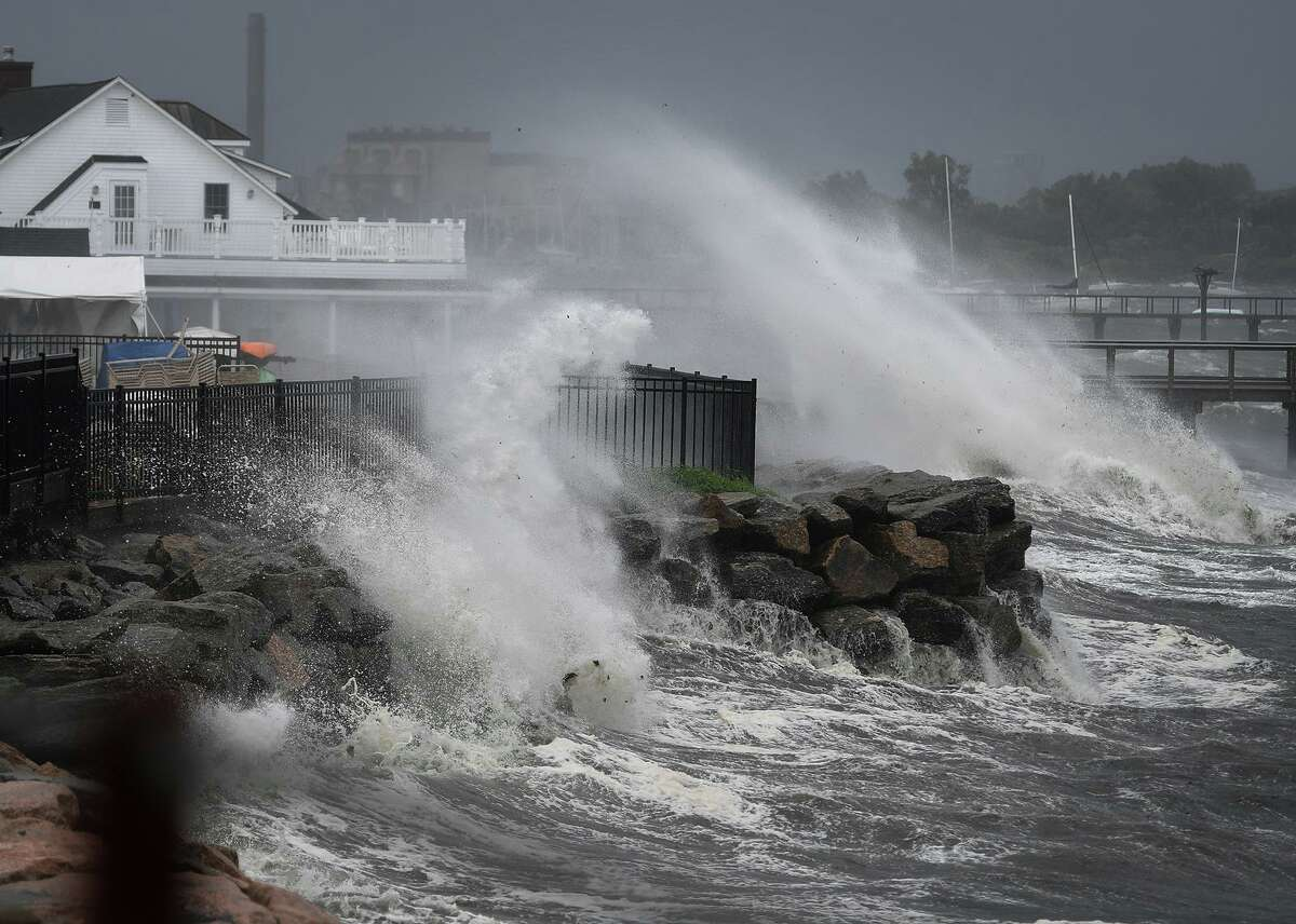 Waves breaks over the Black Rock Yacht Club as Tropical Storm Isaias kicks up the surf on the Sound in the Black Rock section of Bridgeport, Conn. on Tuesday, August 4, 2020. Friday, July 31 After tracking the storm for six days, Eversource files recovery plans with state regulators calling for a Level 4 storm, with outages up to 30 percent of customers, or 380,000. Sunday, Aug. 2 At 11 a.m., an email from White House aide Nic Pottebaum asks Gov. Ned Lamont's chief of staff, Paul Mounds, to let him know if there are unmet federal needs in the state's response arsenal.
