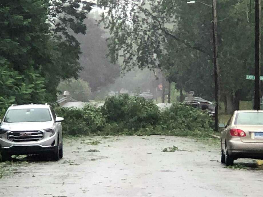 A tree blocks the road at the intersection of Park Avenue and East Lawton Street in Torrington Tuesday evening. v Photo: Amy Petittv / Contributed Photo /