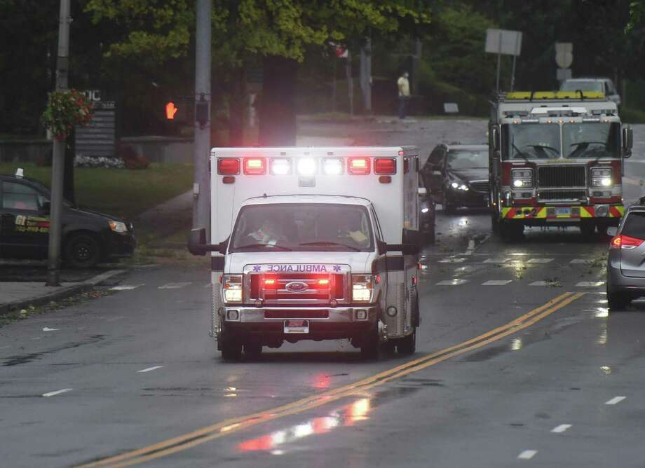 Greenwich EMS responds to an incident as Tropical storm Isaias brings heavy wind and rain in Greenwich, Conn. Tuesday, Aug. 4, 2020. The National Weather Service issued a tropical storm warning, flash flood watch, and tornado watch as the storm passed through Connecticut. Photo: Tyler Sizemore / Hearst Connecticut Media / Greenwich Time