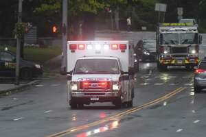 Greenwich EMS responds to an incident as Tropical storm Isaias brings heavy wind and rain in Greenwich, Conn. Tuesday, Aug. 4, 2020. The National Weather Service issued a tropical storm warning, flash flood watch, and tornado watch as the storm passed through Connecticut.