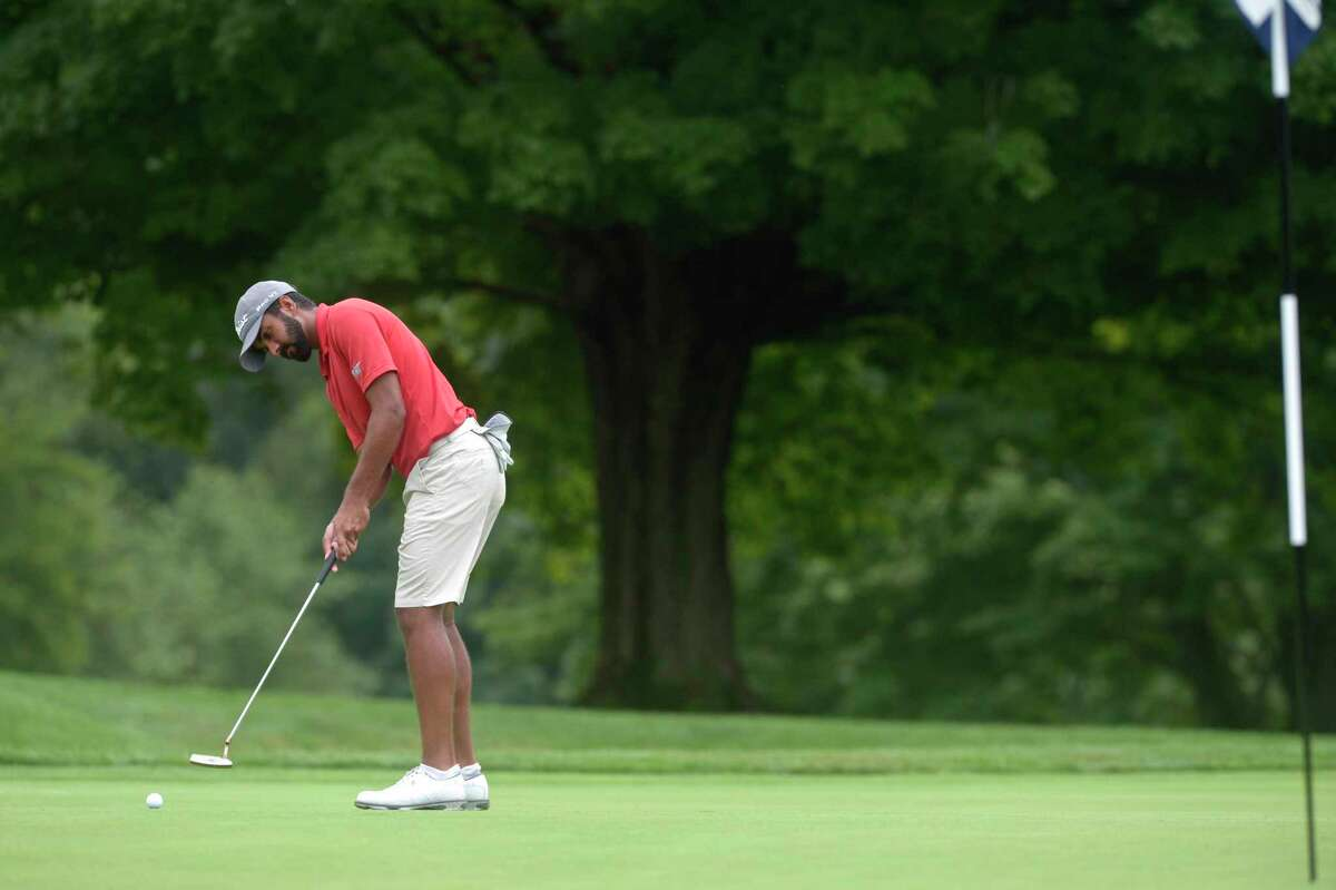 Saptak Talwar, from Great River Golf Course, putts on the 4th hole in the second round of the Connecticut Open tournament at Ridgewood CC in Danbury on Tuesday.