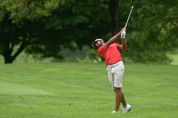 Saptak Talwar, seen here on Tuesday, remains in the lead at the Connecticut Open, held at Ridgewood Country Club in Danbury.