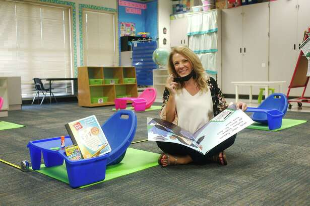 School supplies typically stored in community bins will be kept this fall in students' individual lap desks in the classroom of North Point Elementary School kindergarten teacher Rosemay Lagrone. Kindergarten and prekindergarten classes will be much different than in the past, says Lagrone, who was on Clear Creek ISD's safe reopening committee.