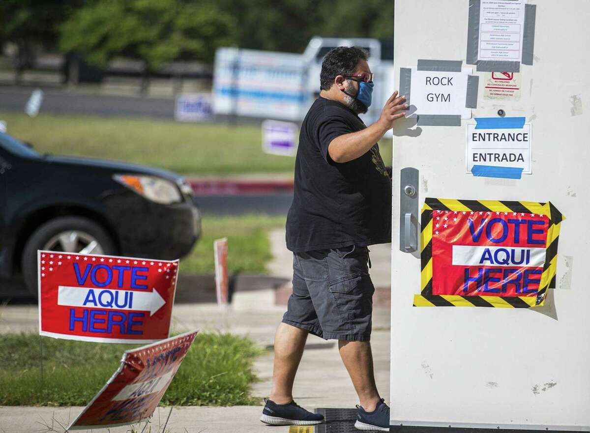 Voter Ed Martinez make his way to vote at Pflugerville ISD Rock Gym in the Election Day Primary Runoff on Tuesday , July 14, 2020. (Ricardo B. Brazziell/Austin American-Statesman/TNS)