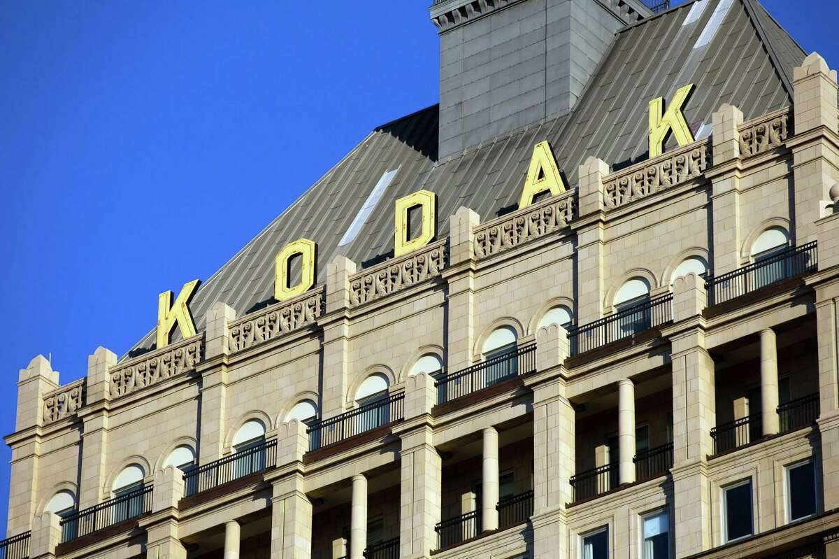 Signage is displayed outside Kodak Tower at the Eastman Kodak Co. headquarters complex in Rochester, New York, U.S., on Saturday, Aug.1, 2020. Eastman Kodak Co.A plans to make ingredients for generic drugs, aided by a $765 million U.S. governmentA loan, the first fruits of a Trump Administration program aimed at bolstering American drug-making capabilities in the age of Covid-19. Photographer: Mike Bradley/Bloomberg