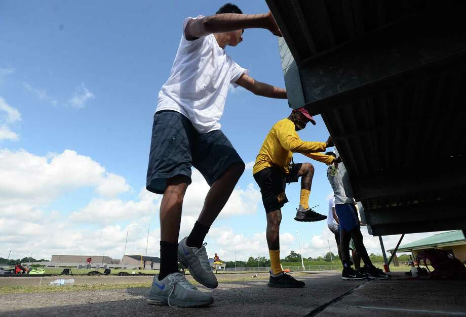 Football players work out as summer conditioning begins at Beaumont United Monday morning. While most schools started the summer workouts when the state permitted last week, BISD programs waited until this week to hold camps. Photo taken Monday, June 15, 2020 Kim Brent/The Enterprise Photo: Kim Brent / The Enterprise / BEN