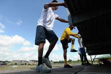 Football players work out as summer conditioning begins at Beaumont United Monday morning. While most schools started the summer workouts when the state permitted last week, BISD programs waited until this week to hold camps. Photo taken Monday, June 15, 2020 Kim Brent/The Enterprise