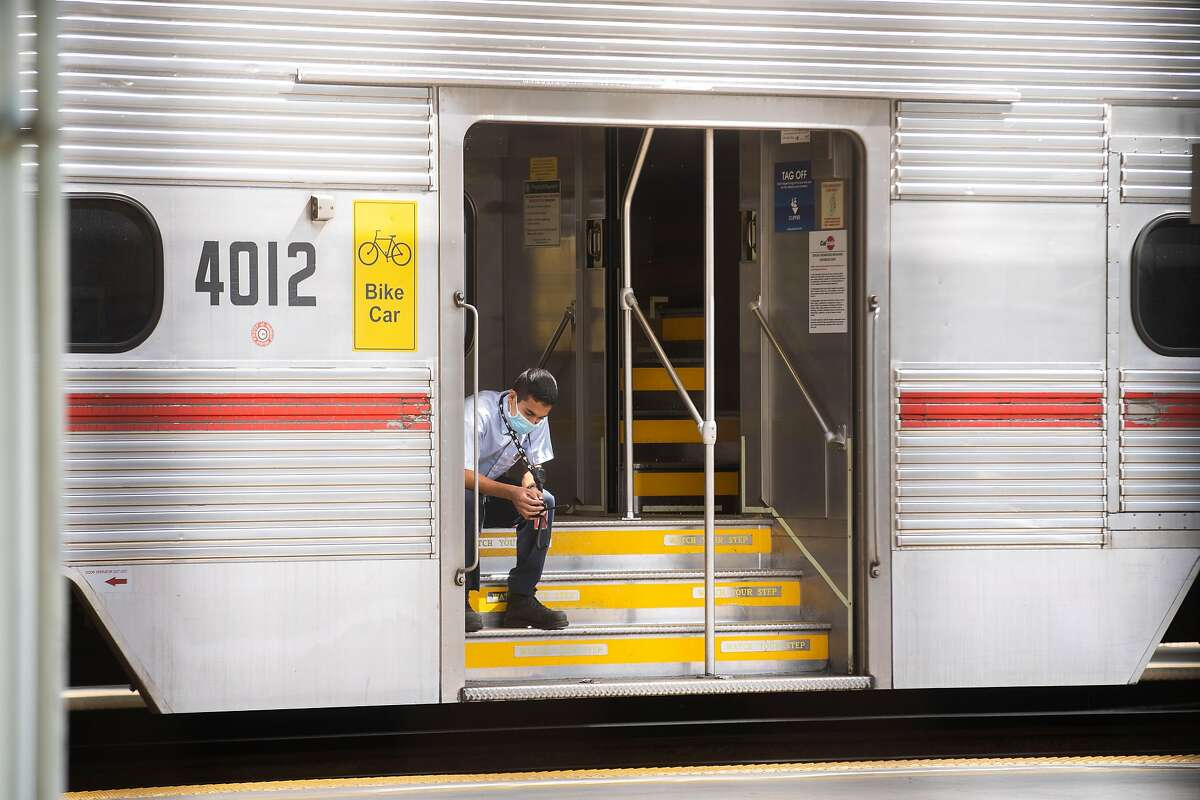 A Caltrain official at the 4th and King streets station. Caltrain is grappling with a fiscal crisis and questions about the future of public transportation.