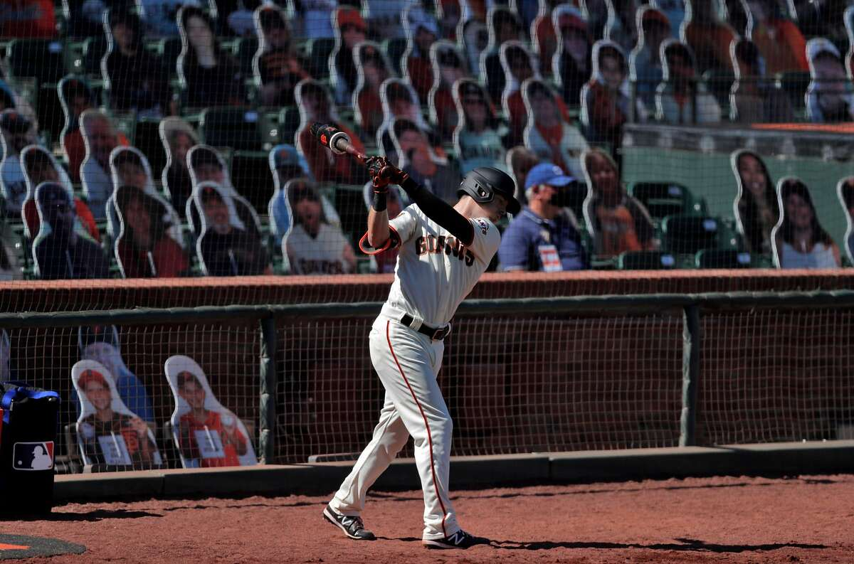 Mike Yastrzemski (5) taking swings in the on deck circle in the seventh inning as the San Francisco Giants played the Texas Rangers at the Oracle Park in San Francisco, Calif., on Sunday, August 2, 2020.