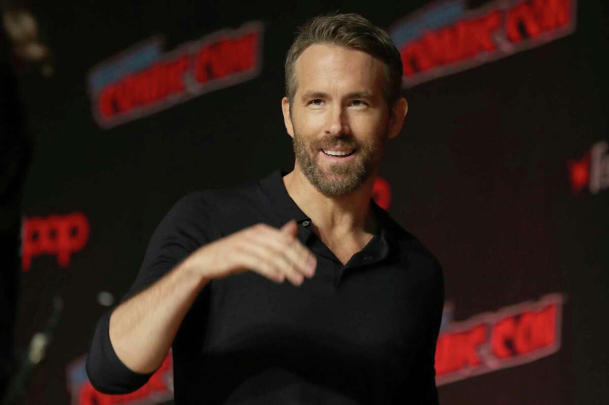 FILE - This Oct. 3, 2019 file photo shows Ryan Reynolds at New York Comic Con. Stay-at-home orders, traveling fears and the cancellation of sporting events, concerts and theme parks have forced the Make-a-Wish foundation to come to a stand-still, leaving young peoplea€™s requests in holding patterns. The charity has introduced a€œMessages of Hope,a€ encouraging the public and celebrities to record inspiring messages and upload them to social media, and so far, stars like Reynolds have already participated. (AP Photo/Steve Luciano, File)