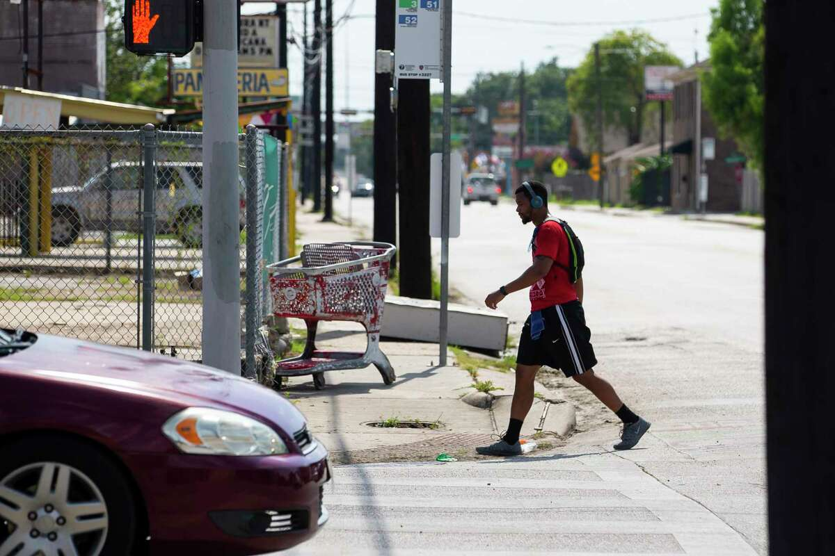 A man crosses Hogan Street at Fulton Street on Tuesday, Aug. 4, 2020, in the Near Northside neighborhood of Houston. The City of Houston is voting Wednesday on a new