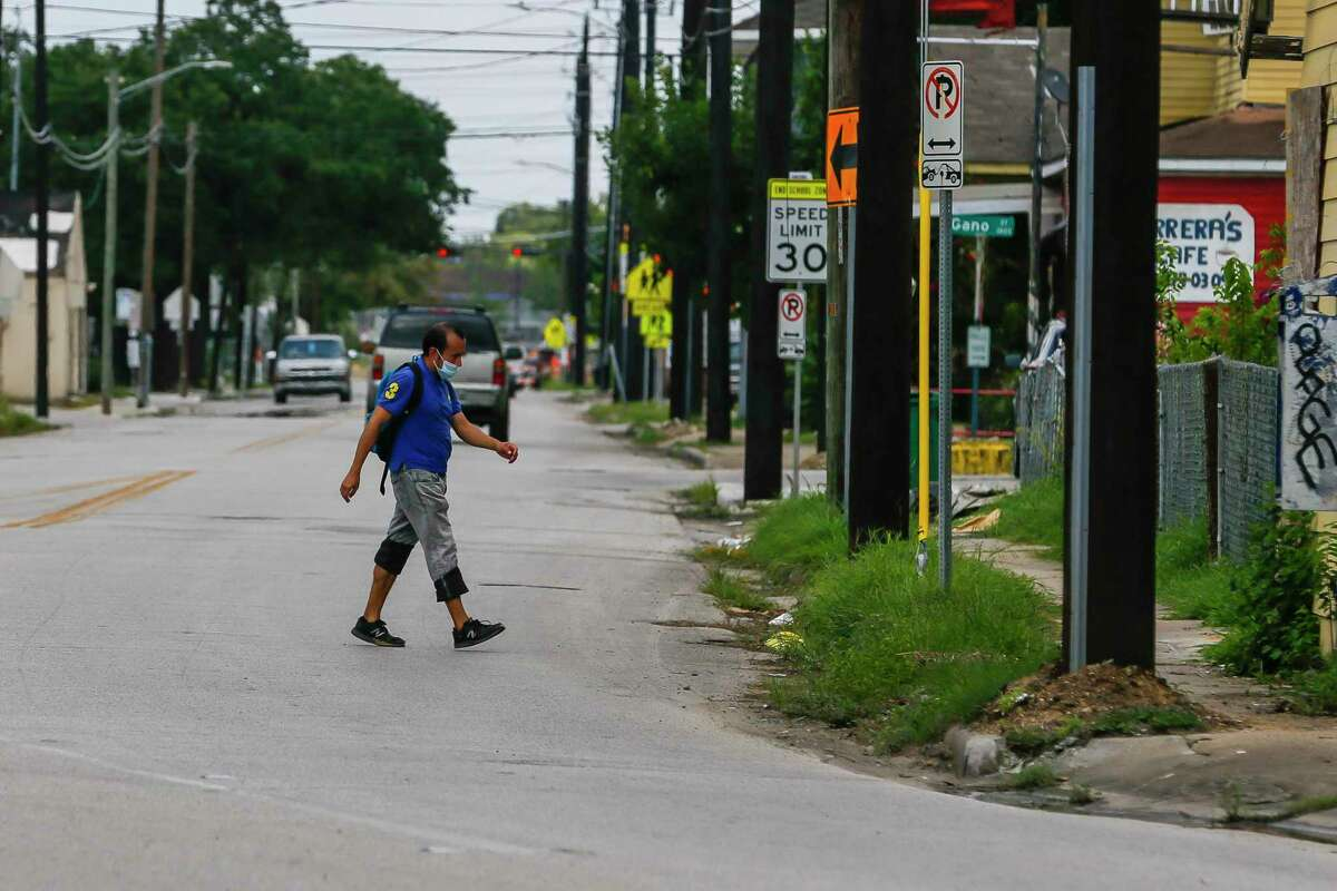 A man crosses Hogan Street where it curves and turns into Lorraine Street on Tuesday, Aug. 4, 2020, in the Near Northside neighborhood of Houston. The City of Houston is voting Wednesday on a new