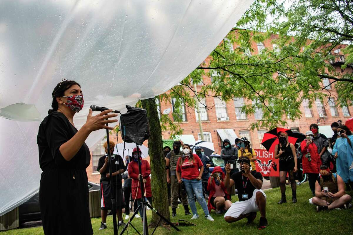 Rep. Rashida Tlaib, D-Mich., addresses demonstrators near the Rosa Parks Federal Building on Saturday in Detroit. Brenda Jones, the Detroit City Council president, is challenging Tlaib in the Tuesday primary.