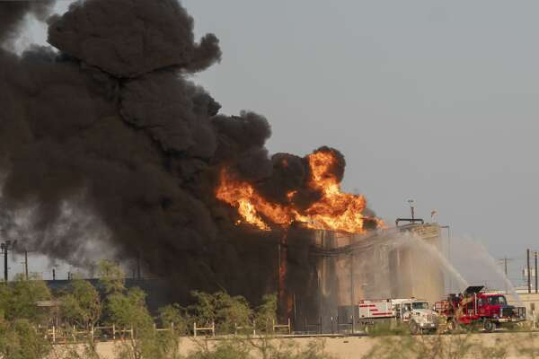 Fire fighters battle a tank battery fire 8/04/2020 evening south of I-20 and just east of Lamesa Road. Tim Fischer/Reporter-Telegram