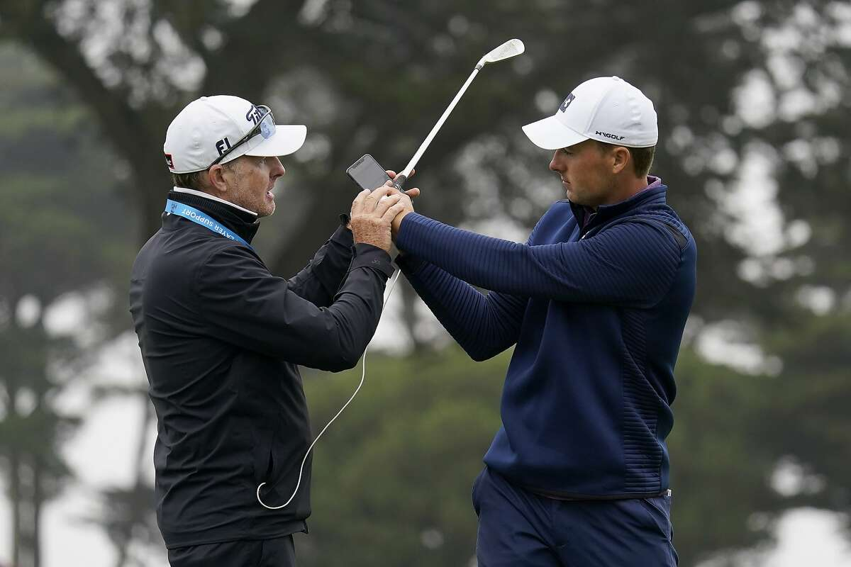 Jordan Spieth, right, gets instruction from Cameron McCormick during practice for the PGA Championship golf tournament at TPC Harding Park in San Francisco, Tuesday, Aug. 4, 2020. (AP Photo/Jeff Chiu)