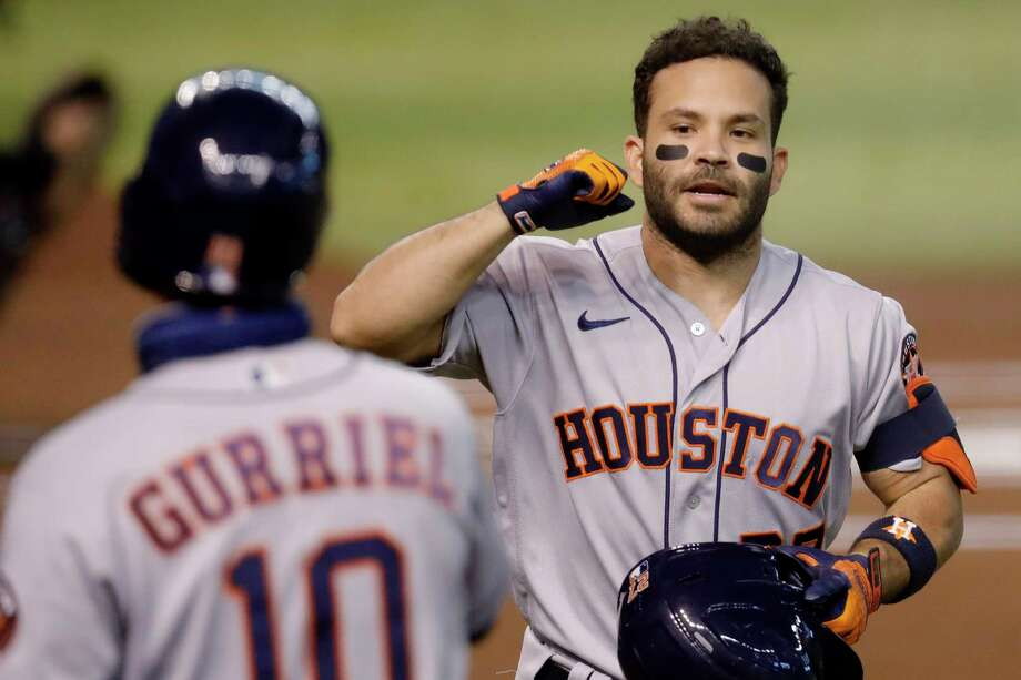 Houston Astros Jose Altuve (27) celebrates with Yuli Gurriel (10) after hitting a solo home run against the Arizona Diamondbacks during the first inning of a baseball game Tuesday, Aug. 4, 2020, in Phoenix. (AP Photo/Matt York) Photo: Matt York, Associated Press / Copyright 2020 The Associated Press. All rights reserved