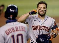 Houston Astros Jose Altuve (27) celebrates with Yuli Gurriel (10) after hitting a solo home run against the Arizona Diamondbacks during the first inning of a baseball game Tuesday, Aug. 4, 2020, in Phoenix. (AP Photo/Matt York)