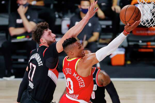 Houston Rockets' Russell Westbrook shoots the ball next to Portland Trail Blazers' Jusuf Nurkic #27 during the first half of an NBA basketball game Tuesday, Aug. 4, 2020, in Lake Buena Vista, Fla. (Kevin C. Cox/Pool Photo via AP)