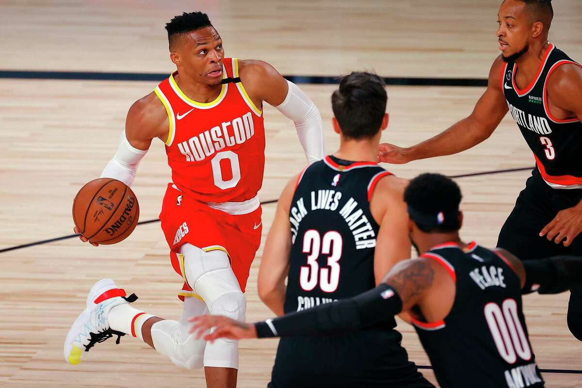 Houston Rockets' Russell Westbrook (0) drives to the basket against the Portland Trail Blazers during the first half of an NBA basketball game Tuesday, Aug. 4, 2020, in Lake Buena Vista, Fla. (Kevin C. Cox/Pool Photo via AP)