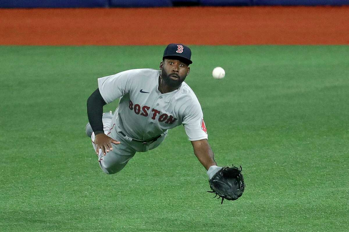 Boston Red Sox center fielder Jackie Bradley Jr. (19) makes a diving catch on a flyout by Tampa Bay Rays' Brandon Lowe during the third inning of a baseball game Tuesday, Aug. 4, 2020, in St. Petersburg, Fla. (AP Photo/Chris O'Meara)