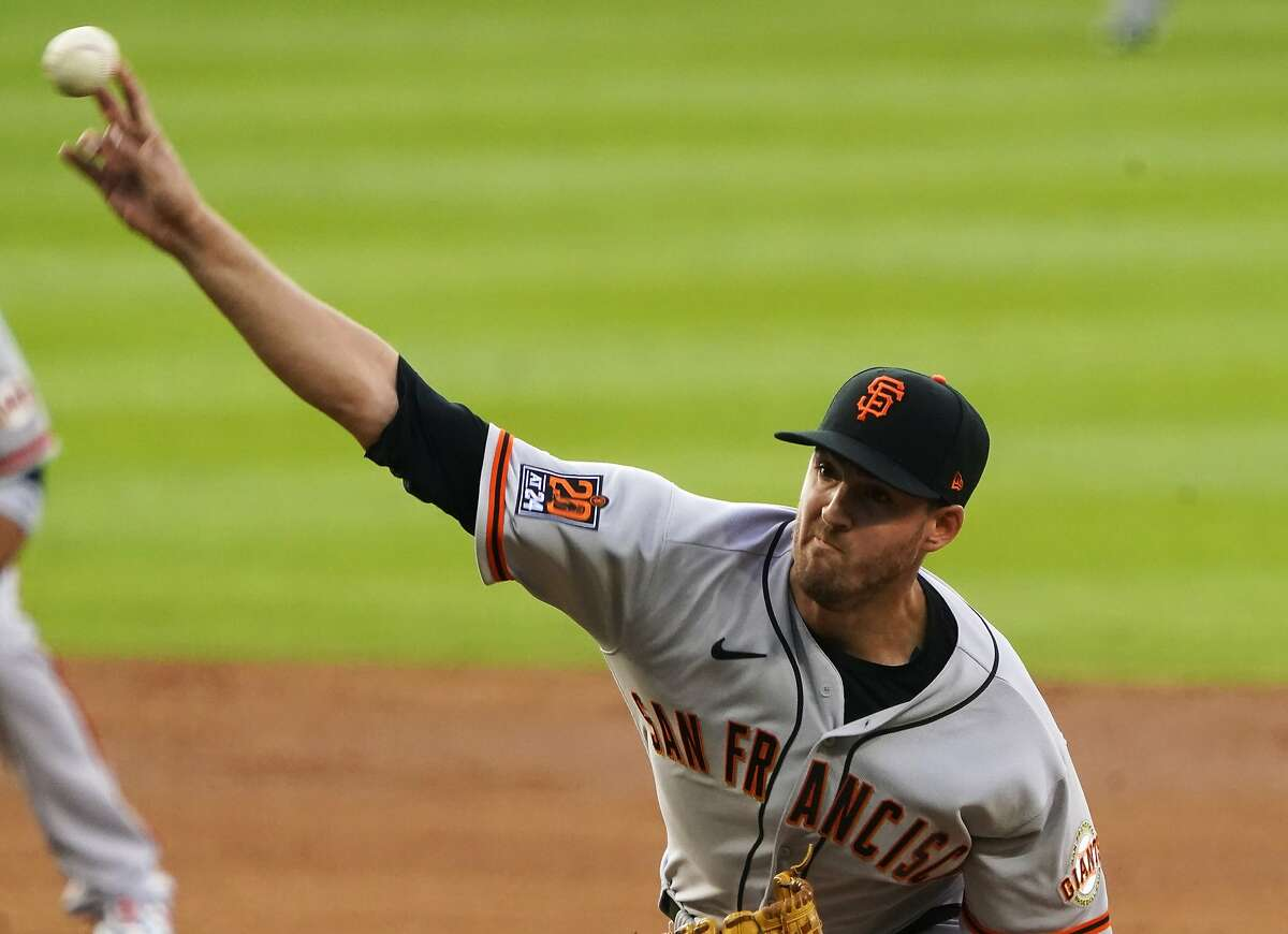 San Francisco Giants starting pitcher Kevin Gausman (34) throws against the Colorado Rockies during the first inning of a baseball game, Tuesday, Aug. 4, 2020, in Denver. (AP Photo/Jack Dempsey)