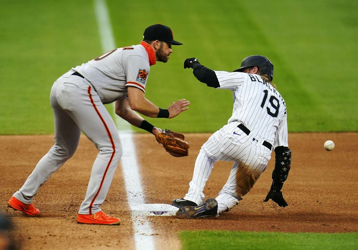 Colorado Rockies' Charlie Blackmon (19) slides safe into third against San Francisco Giants third baseman Evan Longoria (10) during the fourth inning of a baseball game, Tuesday, Aug. 4, 2020, in Denver. (AP Photo/Jack Dempsey)